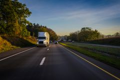 Semi-truck 18 wheeler running on the highway stock photos