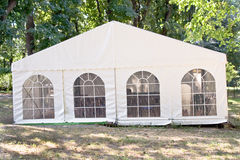 White big tent. In forest Royalty Free Stock Images