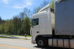 White big truck in motion on highway Stock Photos