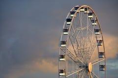 White big wheel. Illuminated white big wheel at dawn royalty free stock photo