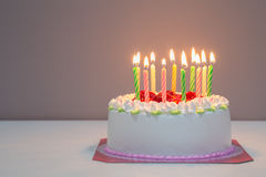 White biirthday cake with candles Royalty Free Stock Photos
