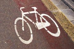 White bike lane sign. On the street Royalty Free Stock Photos