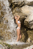 White bikini and waterfall Stock Image