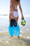 White bikini woman with flippers and goggles. Woman at sandy beach in Cadiz Andalusia Spain Stock Photography