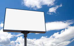 White bill board. Advertisement under blue sky with clouds royalty free stock image