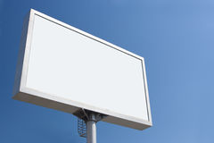 White bill board advertisement. Under blue  sky Royalty Free Stock Photo
