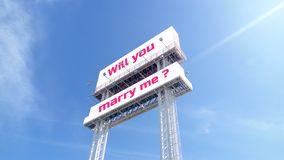 White bill board on clear blue sky with text wording Will you marry me? For Valentines, wedding events, exhibition fair stock image