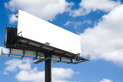 White Billboard. Blank double back to back billboard with partly cloudy sky Royalty Free Stock Photos