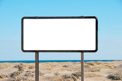 White billboard. On the beach, blue sky, copy-space stock images