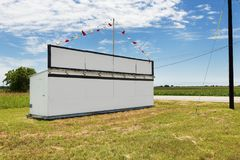 White billboard along a country road in rural Texas royalty free stock photo