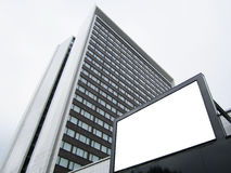White billboard on the background of a skyscraper office building, mock up Stock Images