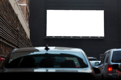 White billboard on the black wall. Stock Photo