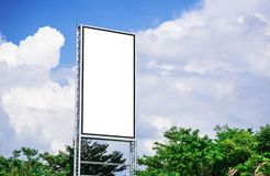 White billboard blank canvas mockup for outdoor advertising poster or blank billboard at day time and cloud and blue sky. Background royalty free stock photos