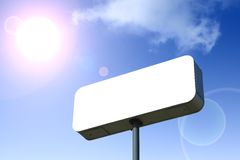 White Billboard, Blue Sky Behind. Outlined With Clipping Path. Royalty Free Stock Photo