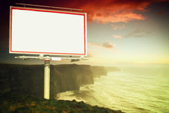 White billboard and cliffs of Moher at sunset Stock Images