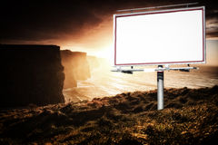 White billboard and cliffs of Moher at sunset Stock Photography
