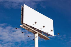 White billboard with cloudy sky on background Stock Images