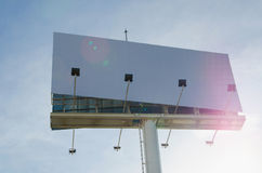 White billboard with cloudy sky on background Royalty Free Stock Images