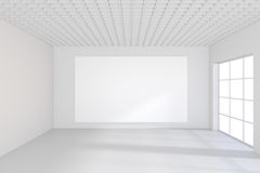 White billboard in an empty office with large windows and beautiful diffused light from the window. 3D rendering.  Royalty Free Stock Photos