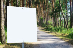 White billboard at the park with space for your advertisement Stock Images