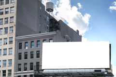 White Billboard on the roof. Big, white, blank, billboard on the roof. Also visible water wooden tank royalty free stock images