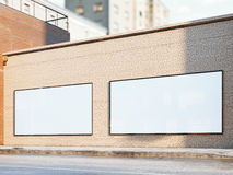 White billboards on the street. 3d rendering. White billboards on a brick wall. 3d rendering Stock Image