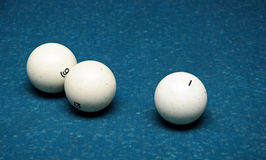 White billiard ball. On a green table Royalty Free Stock Photography