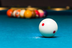 White billiard ball. Closeup of the white ball on a pool table Royalty Free Stock Image