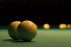 White Billiard Balls on Green Pool Table Stock Photo