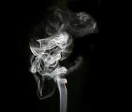 White billowing smoke. A hint of browns in a smoky white abstract on black Royalty Free Stock Image