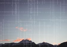 White binary code against mountain tops and sky. Digital composite of White binary code against mountain tops and sky Royalty Free Stock Photography