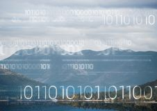 White binary code against mountain and water. Digital composite of White binary code against mountain and water Stock Image