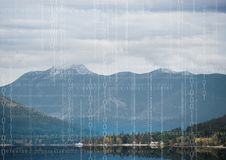 White binary code against mountain and water. Digital composite of White binary code against mountain and water Stock Photography