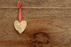 White Birch Love Valentine's heart hanging on wooden texture bac. White birch Love Valentine's heart with gingham ribbon on natural cord and red clip hanging on Stock Image