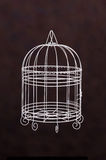 White birdcage isolate with dark brown background Royalty Free Stock Images