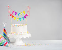 White Birthday Cake colorful bunting Stock Photo