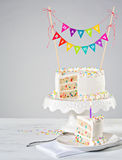 White Birthday Cake colorful bunting Stock Photography
