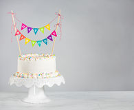 White Birthday Cake colorful bunting Royalty Free Stock Photography
