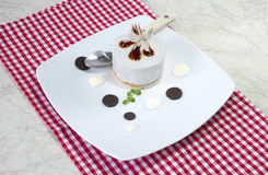 White biscuit with spoon Royalty Free Stock Photo
