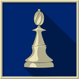 White bishop. Chess. White bishop on a blue background Royalty Free Stock Images