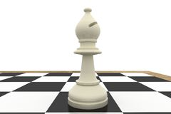 White bishop on chess board Stock Photos