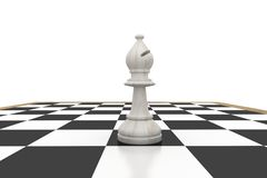 White bishop on chess board Stock Photo