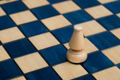 White bishop on wooden chessboard Stock Image