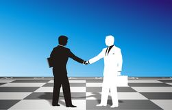 White and Black. On the chessboard black and white figures shaking hands Royalty Free Stock Photography