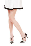 White and black. Slim long woman legs in stylish black and white patent-leather shoes Royalty Free Stock Image