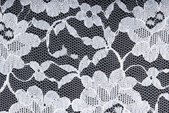 White on black. White textured lace on a black background Royalty Free Stock Photos