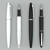 White and black ball pens mockup on bright bacground Royalty Free Stock Images