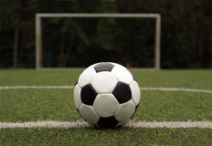 White and black ball for playing soccer against ga Royalty Free Stock Photo