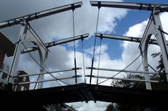 White and black bridge against a clouded blue sky in Leiden the Netherlands.  stock image