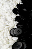 White and black buttons. A lot of white and black buttons texture stock photos